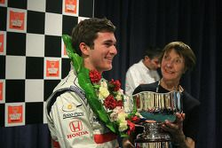Connor de Phillippi receives the Walter Hayes Trophy from Elizabeth Hayes