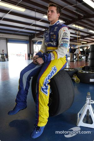 Trevor Bayne, driver of the Toyota Nationwide COT, sits on a tire