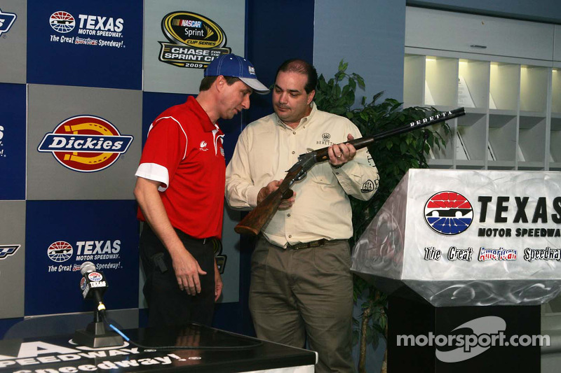 David Reutimann looks at his image on the Beretta shotgun trophy from 2008