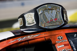 Kyle Busch's WWE belt sits atop his No. 18 Z-Line Designs/ WWE Smackdown vs Raw Toyota