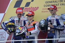 Podium: race winner Dani Pedrosa, Repsol Honda Team, second place Valentino Rossi, Fiat Yamaha Team,