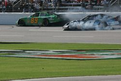 Morgan Shepherd and Jeremy Clements come together on the front straight