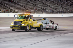 Ben Stancill's Chevrolet is towed back to the garage area