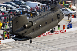 The US Army Reserve Command, 11th Aviation Command, and the 7-158th Aviation Regiment delivers the pace car in a Chinook Helicopter