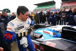 French Prime Minister François Fillion drives the Peugeot 908 HDi FAP, winner of the last 24 Hours