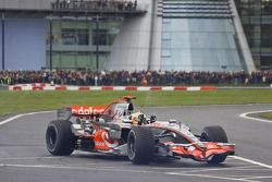 Lewis Hamilton does no handed doughnuts