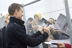 David Coulthard signs autogrpahs for fans