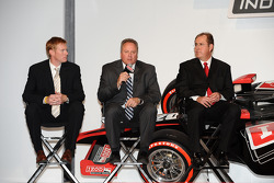 Brian Barnhart, center, president of competition and racing operations for the Indy Racing League, i