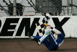 Race winner Carl Edwards celebrates with a somersault on the track