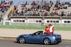 A backup Ferrari California picks up Luca di Montezemolo, Felipe Massa and Fernando Alonso for the d