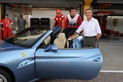 Luca di Montezemolo, Felipe Massa and Fernando Alonso after the drive around the track in a Ferrari