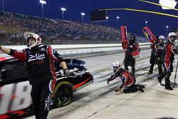 Kyle Busch pulls away from his pit stall during a quick stop