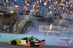 Brad Keselowski spins down the front stretch after being nudged by Denny Hamlin