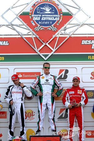 First race podium: winner Michael Schumacher, second place Vitantonio Liuzzi, third place Felipe Mas