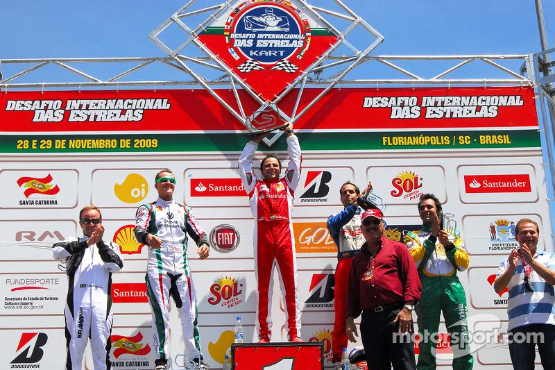 Second race podium: winner Felipe Massa, second place Michael Schumacher, third place Vitor Meira