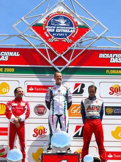 Final podium: overall winner Michael Schumacher, second place Felipe Massa, third place Vitor Meira