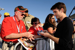 Jeff Gordon signs autographs as he arrives at Las Vegas Motor Speedway for the Roast of four time NASCAR Champion Jimmie Johnson