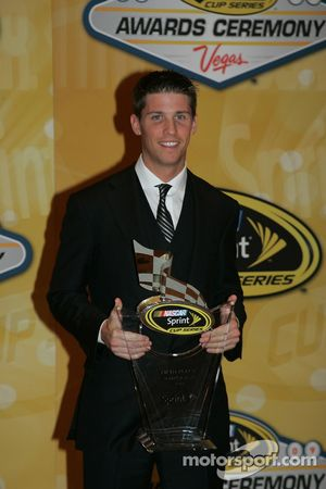 Denny Hamlin with his award for fifth place in the Chase for the NASCAR Sprint Cup
