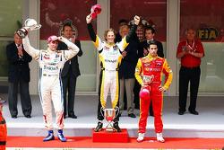 Podium: race winner Romain Grosjean, Barwa Campos Team, second place Vitaly Petrov, Barwa Campos Tea