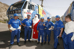 Vladimir Chagin, Firdaus Kabirov and Ilgizar Mardeev pose with Santa Claus