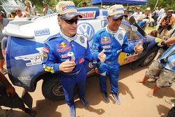 2010 Dakar Rally winners in the cars category Carlos Sainz and Lucas Cruz Senra celebrate