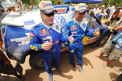 2010 Dakar Rally winners in the cars category Carlos Sainz and Lucas Cruz Senra celebrate