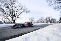 Sebastien Buemi in the Red Bull Racing F1 car in the snow at Circuit Gilles-Villeneuve in Montréal