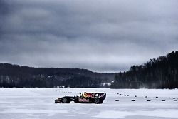 Sebastien Buemi in the Red Bull Racing F1 car in the snow at Circuit Gilles-Villeneuve in Lac-à-l'Eau-Claire, Québec, Canada