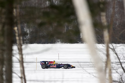 Sebastien Buemi in the Red Bull Racing F1 car in the snow at Circuit Gilles-Villeneuve in Lac-à-l'Eau-Claire, Québec, Canada