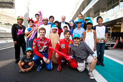 Local children visiting the GP2 paddock with Oliver Turvey and Luca Filippi