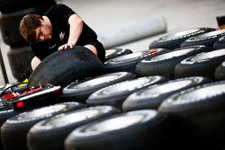 An engineer works on some Bridgestone tyre's