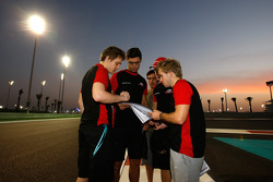 Jules Bianchi and Sam Bird talk with their engineers during a track walk