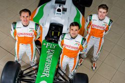 Adrian Sutil with Force India F1 team mate Vitantonio Liuzzi and Paul Di Resta Force India F1 Third Driver with the new Force India VJM03