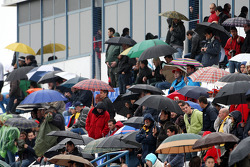 Fans watch the testing in the rain