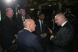 Sir Stirling Moss, Tony Fernandes, Malaysia Racing Team Principal and Mike Gascoyne, Lotus F1 Racing