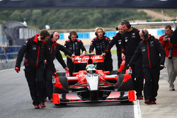 Lucas di Grassi, Virgin Racing is pushed back to the box after stopping in the pit lane