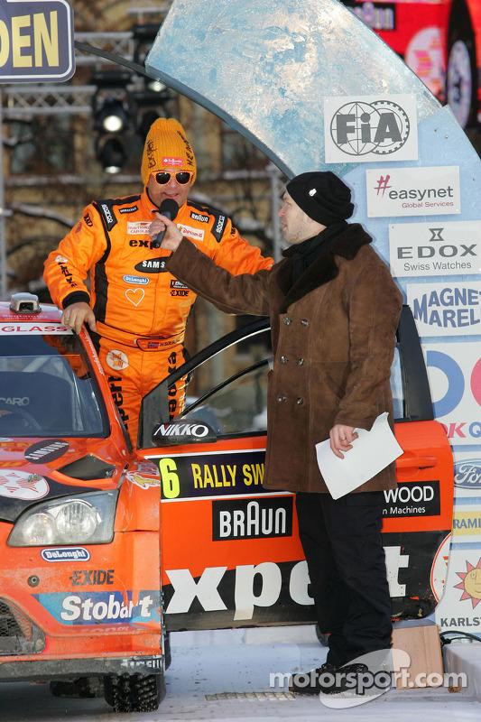 Podium: Henning Solberg en Ilka Minor, Ford Focus RS WRC 08, Stobart VK M-Sport Ford Rally Team