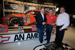 Champion's breakfast: 2010 Daytona 500 winner Jamie McMurray with team owners Chip Ganassi and Felix