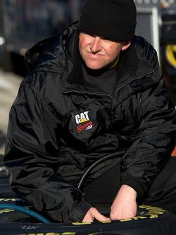 Richard Childress Racing Chevrolet team member prepares wheels