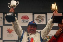 Podium: Garry Holt holds the trophies aloft