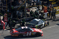 Pit stop for Robby Gordon, Robby Gordon Motorsports Toyota and Tony Stewart, Stewart-Haas Racing Che
