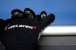 gloves, a Mclaren mechanic