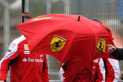 wind gets up, blowing around a Ferrari umbrella
