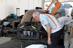 Aston Martin Racing technical boss George Howard Chappell inspects the badly damaged Aston Martin Racing Lola B09 60 Aston Martin after the crash of Harold Primat