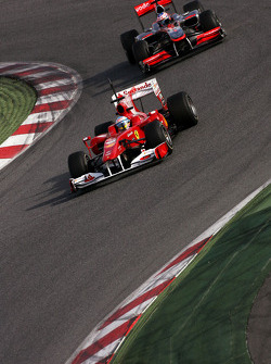 Fernando Alonso, Scuderia Ferrari and Jenson Button, McLaren Mercedes