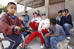 Daniel Sordo and Marc Marti with young fans