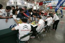 Autograph session for the Citroën Total World Rally Team drivers and co-drivers