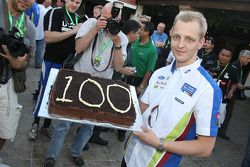 Mikko Hirvonen receives a cake to mark his 100th WRC start in the WRC