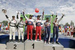 Podium: winnaars Sébastien Loeb en Daniel Elena, Citroën C4, Citroën Total World Rally Team, 2de Pet