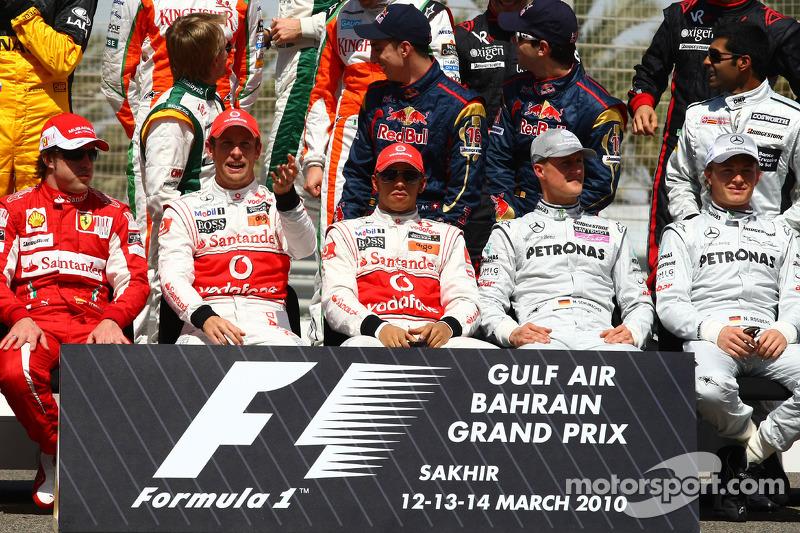 Fernando Alonso, Scuderia Ferrari con Jenson Button, McLaren Mercedes, Lewis Hamilton, McLaren Merce
